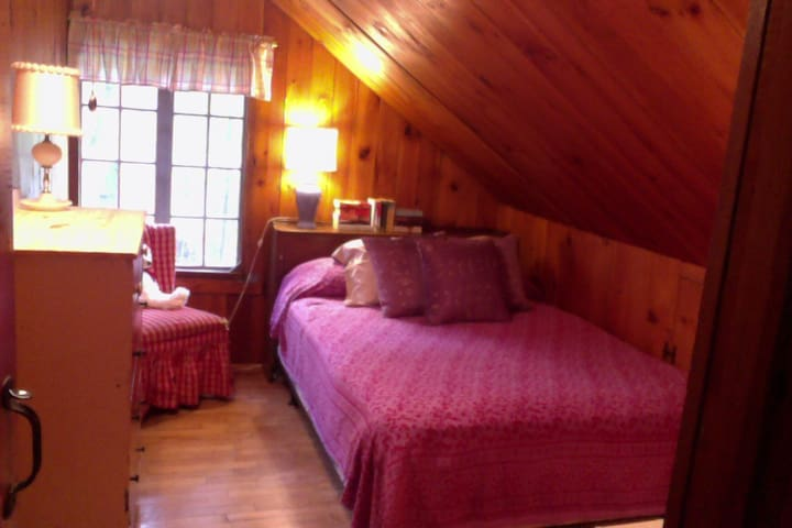 Double bedroom in classic log home