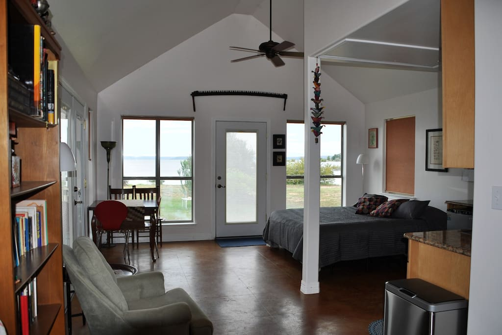 The front living/sleeping area offers generous views of the lake.