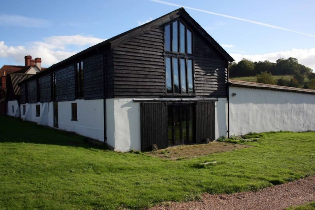 The Old Barns - consists of 4 one bedroom holiday cottages.  Elderberry cottage is the second cottage from this end.
