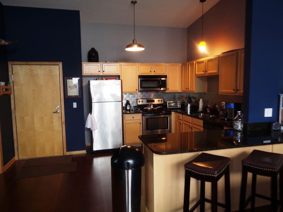 Full kitchen including Kuerig coffee maker.