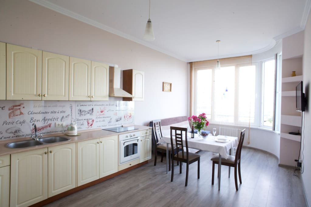 The spacious living room is combined with the the fully equipped kitchen. Here also you can enjoy the view over the sea.