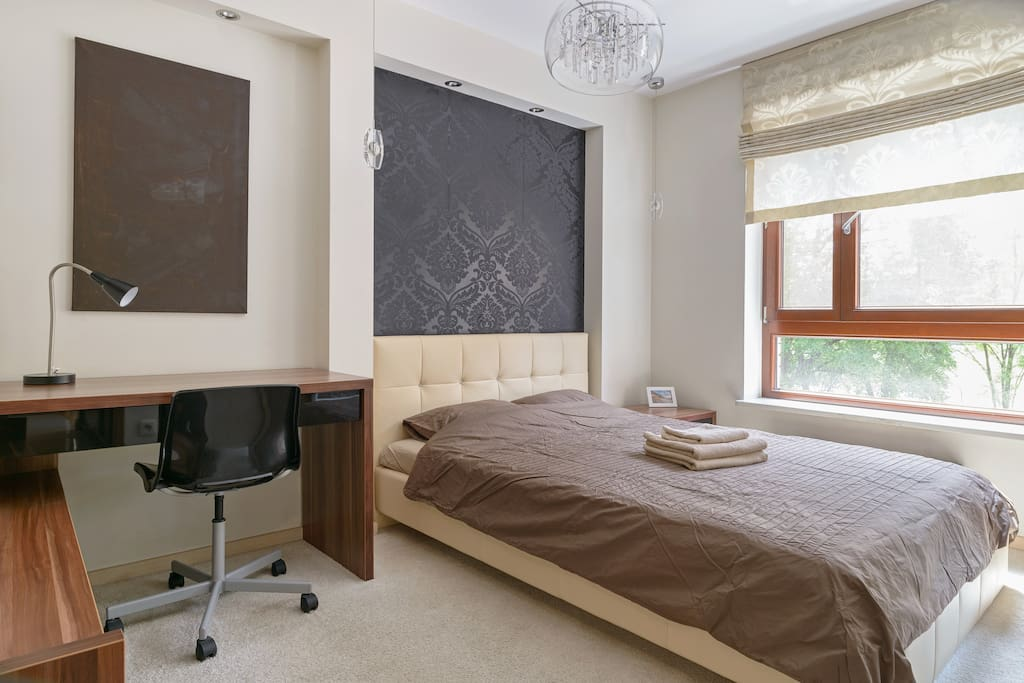 Comfortable and spacious bedroom with a working space
