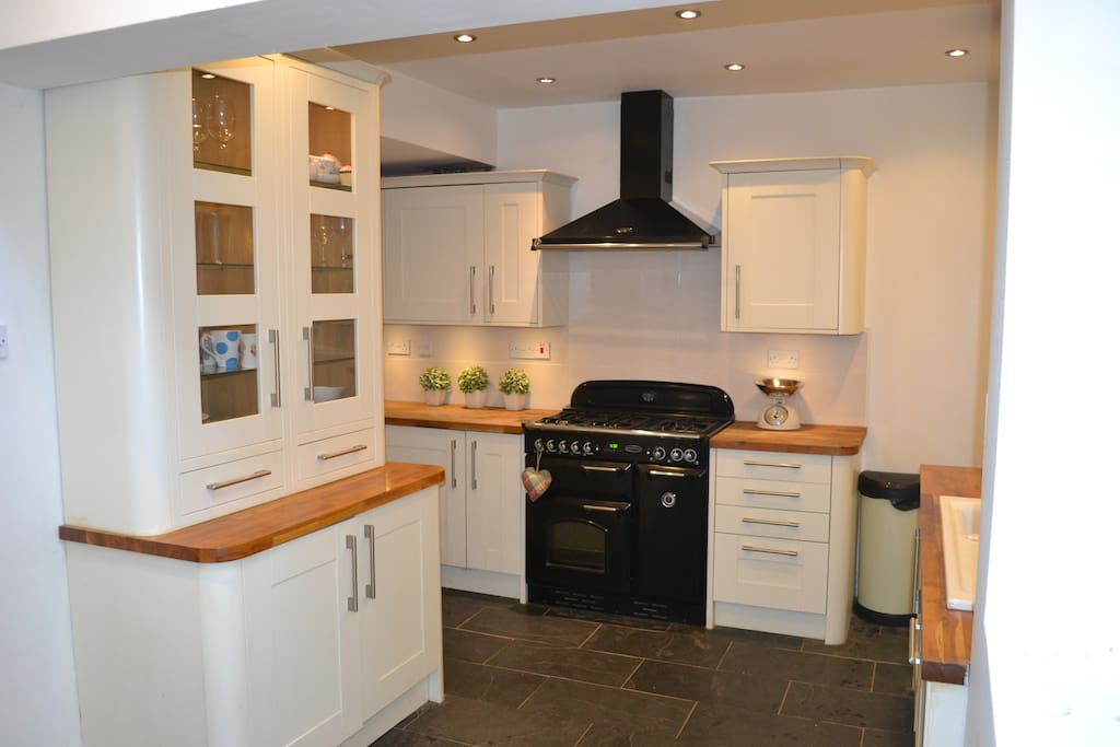Kitchen with gas range cooker