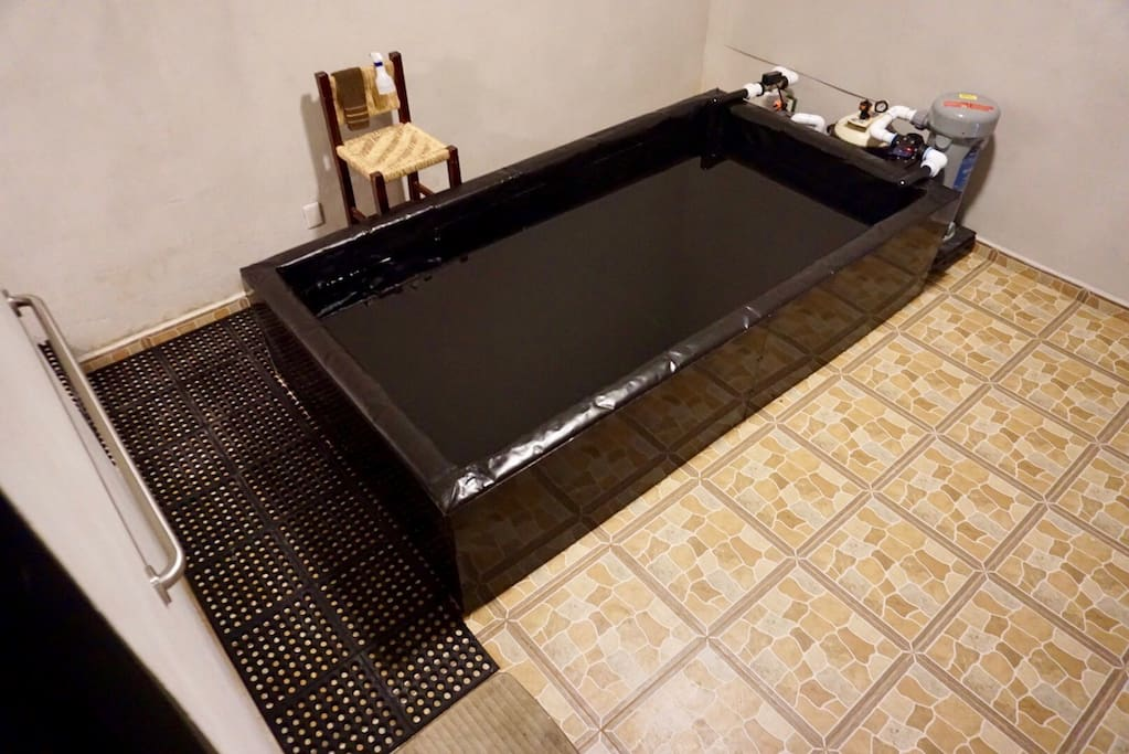 Open float tank, grab bar, and slip resistant flooring
