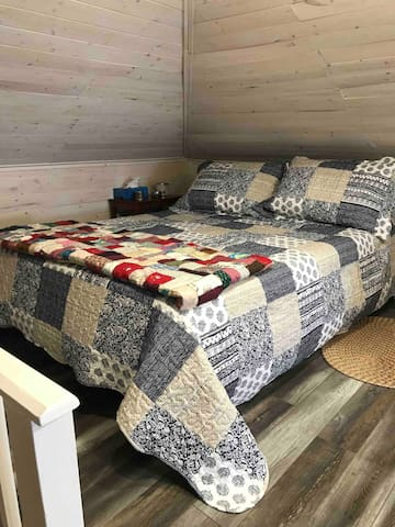 """The double bed in the attic sleeping loft features a comfortable 8"""" gel memory foam mattress (medium support). Access to the sleeping loft is up a set of narrow steps."""
