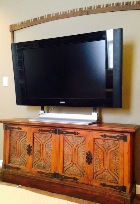 Wide screen TV with cable in living room.