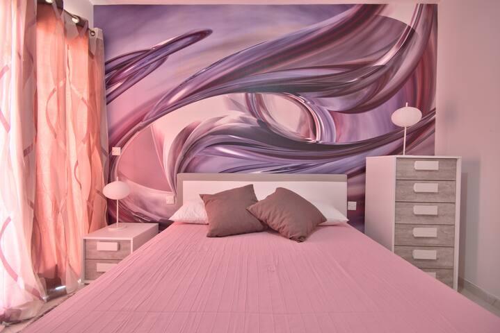 """Camera da letto matrimoniale """"Foulard"""" con possibilità di aggiungere puff letto"""