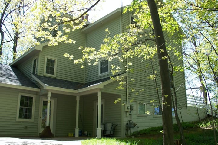 Dog-friendly dream retreat close to town with a water view of Lake Michigan!