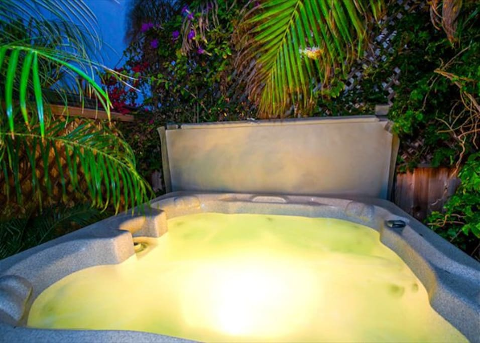 Relax in your private hot tub after a day at the beach.