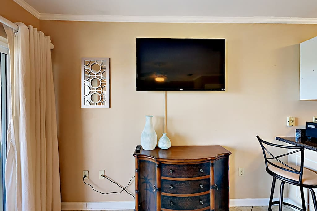 """After a full day of sand and sun, kick back to channel surf on a 50"""" wall-mounted, flat-screen TV."""