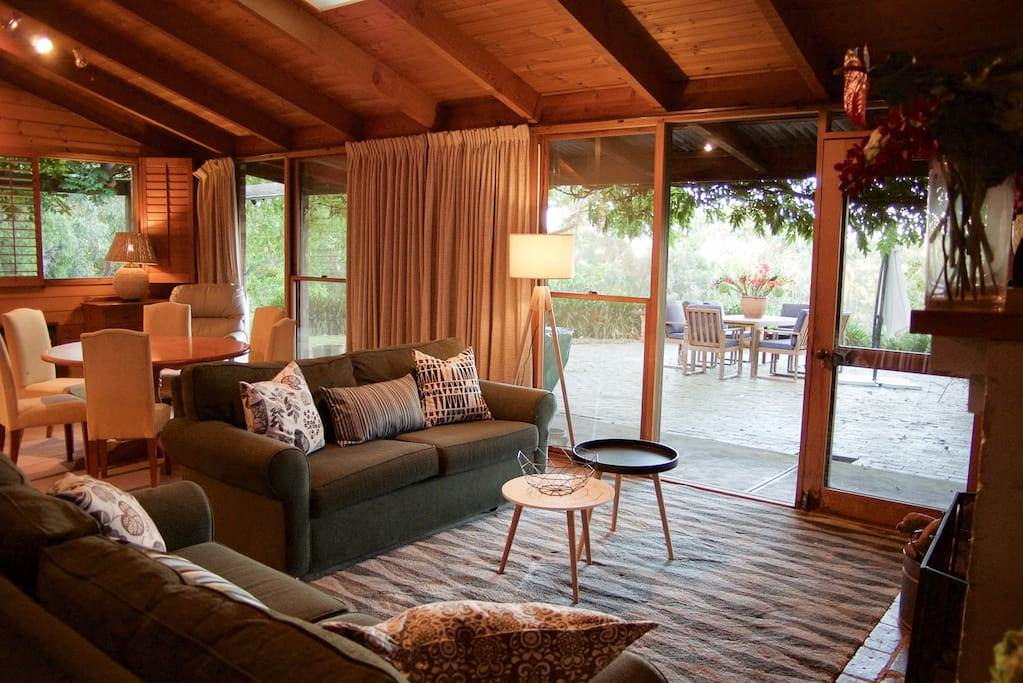 Living area with nice big windows overlooking the outdoor patio and garden