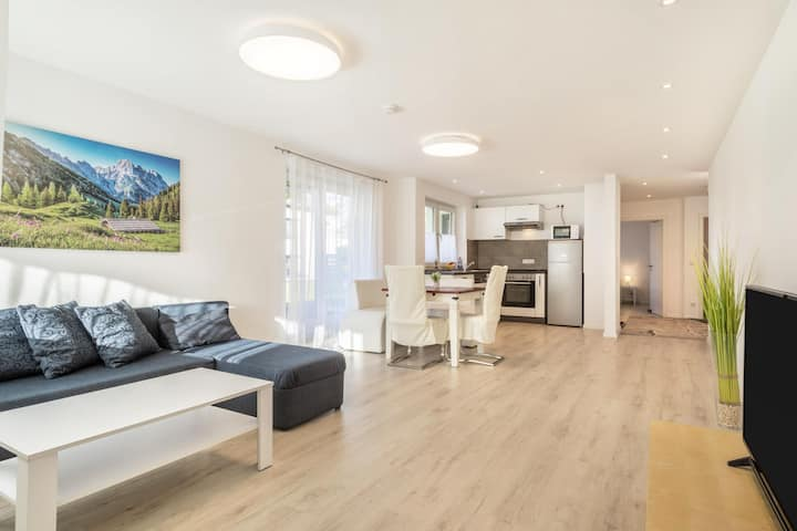 """Light-flooded and Modern """"Apartment Gartenstraße"""" with Terraces, Garden & WiFi; Parking Available"""