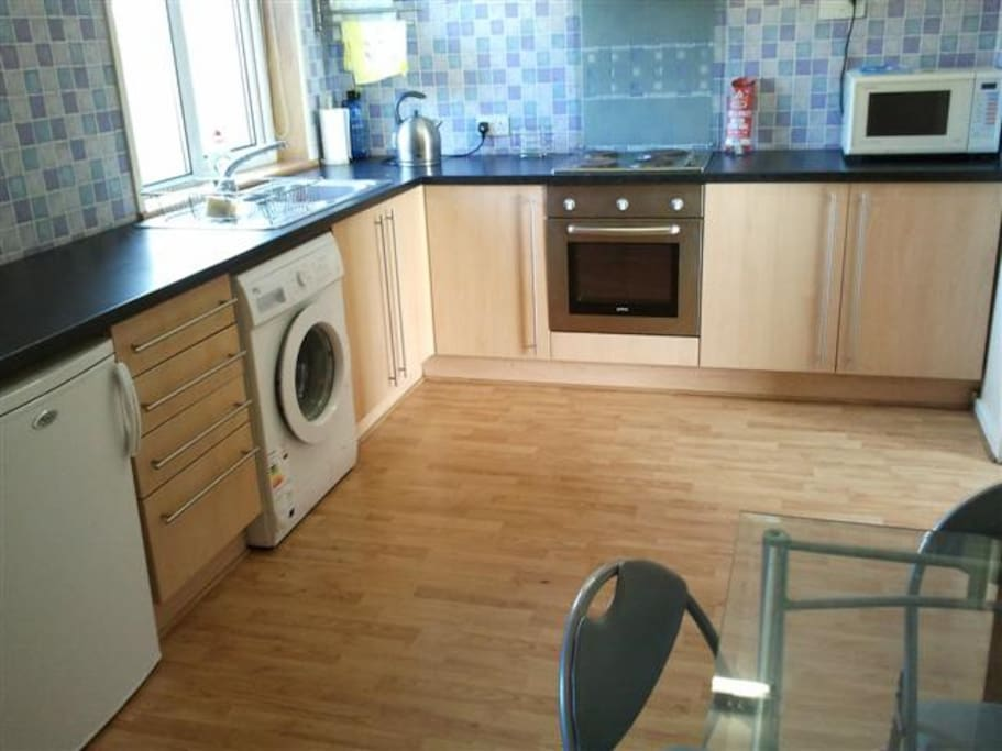 Well appointed kitchen inc freezer, fridge, washing machine, dryer, table and chairs