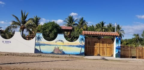 Gated villa with a/c, 4 rooms, and beach view.
