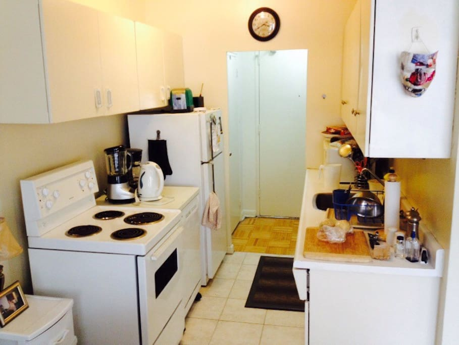 Full kitchen with stove, large refrigerator, portable dishwasher, all inclusive utensils/glasses/plates/bowls, coffee maker, toaster, microwave, blender, kettle, pots and pans.