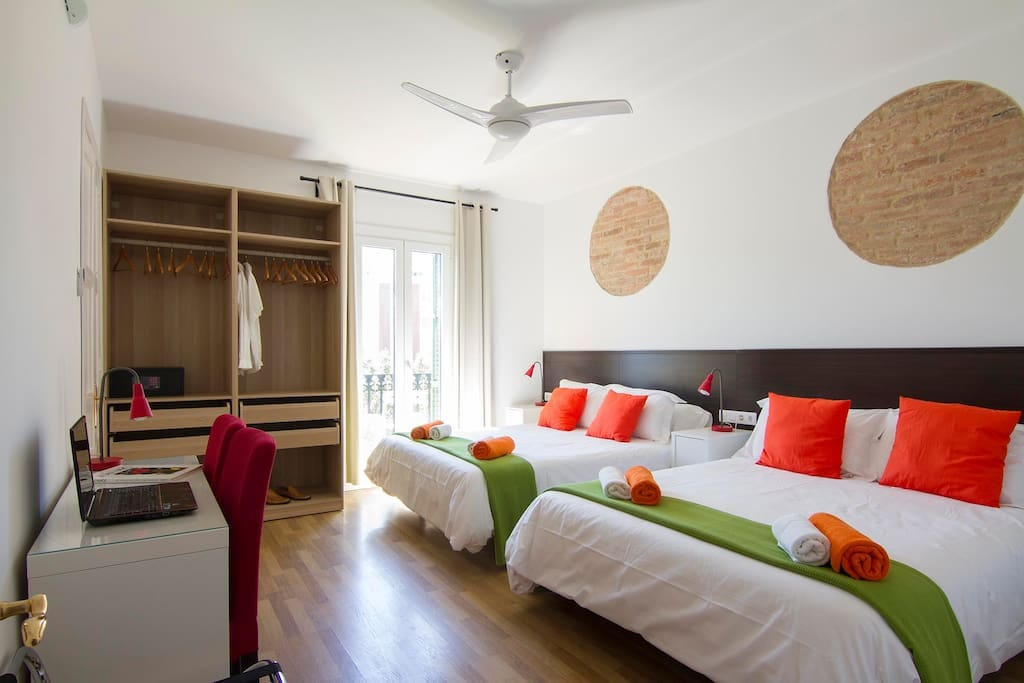 Large bedroom with two queen size beds and private balcony