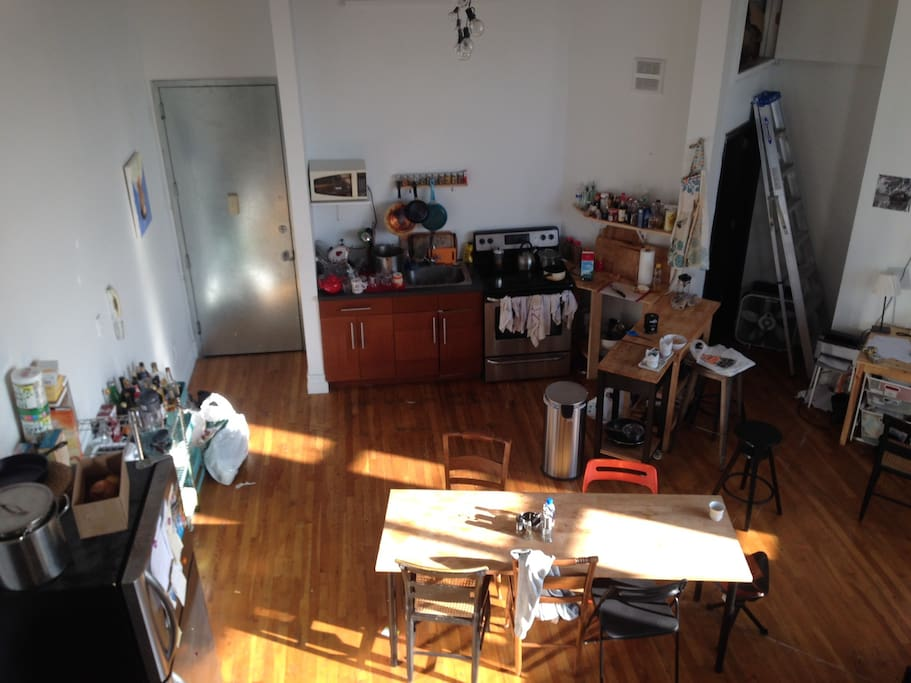 aerial view of kitchen from top of stairs