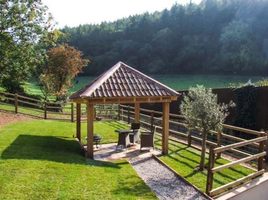 The gazebo with seating, fire pit and BBQ