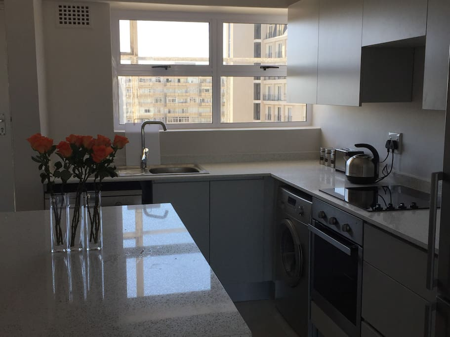 open plan kitchen with all mod cons