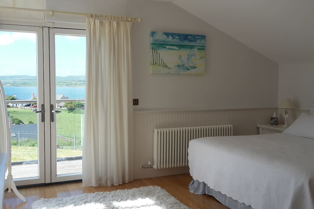 Master bedroom with en-suite and balcony over looking the sea.