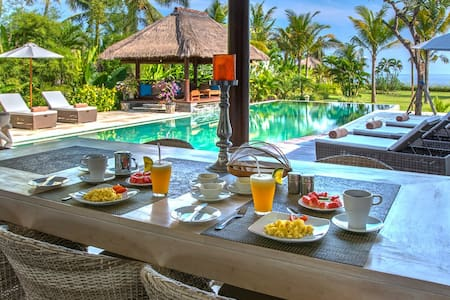 Luxury 4 bedrooms Balinese pool villa on the beach