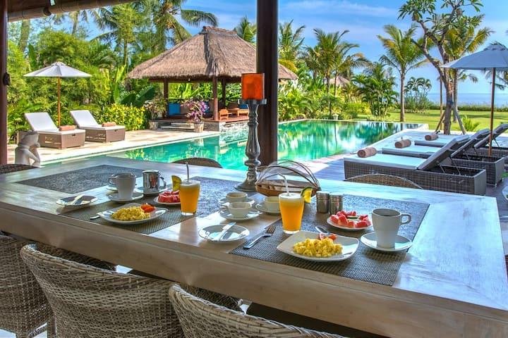Luxury 4 bedrooms Balinese pool villa on the beach