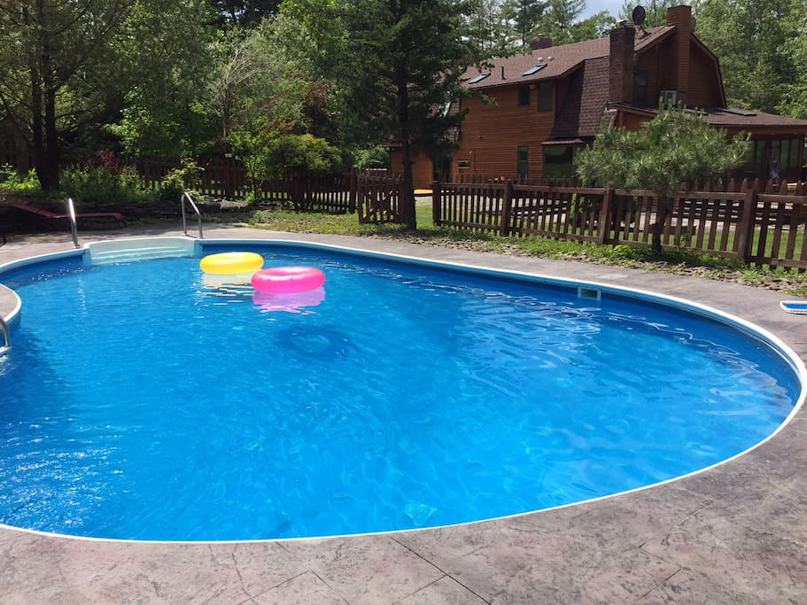 Beautiful UV filtered (nearly chemical free!) pool with house and deck in the background