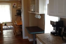 Looking from Full Kitchen into Living/Dining Room