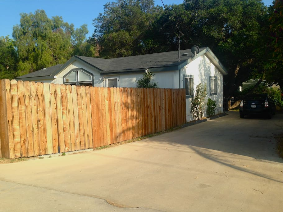 Fenced in front yard with long driveway