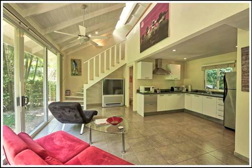 Living room/kitchen & stairs leading to mezzanine