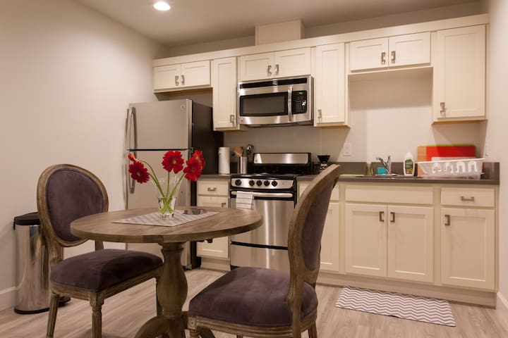 Lovely kitchen with full size fridge, oven, range, microwave, and fully equipped with pots, pans, bakeware, utensils, etc.