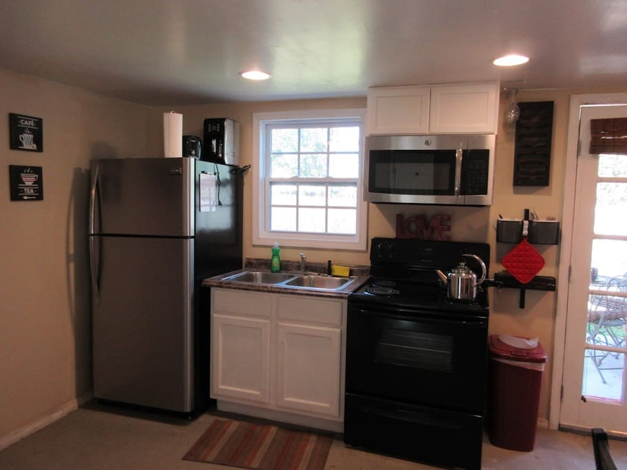 Big refrigerator to store food & microwave