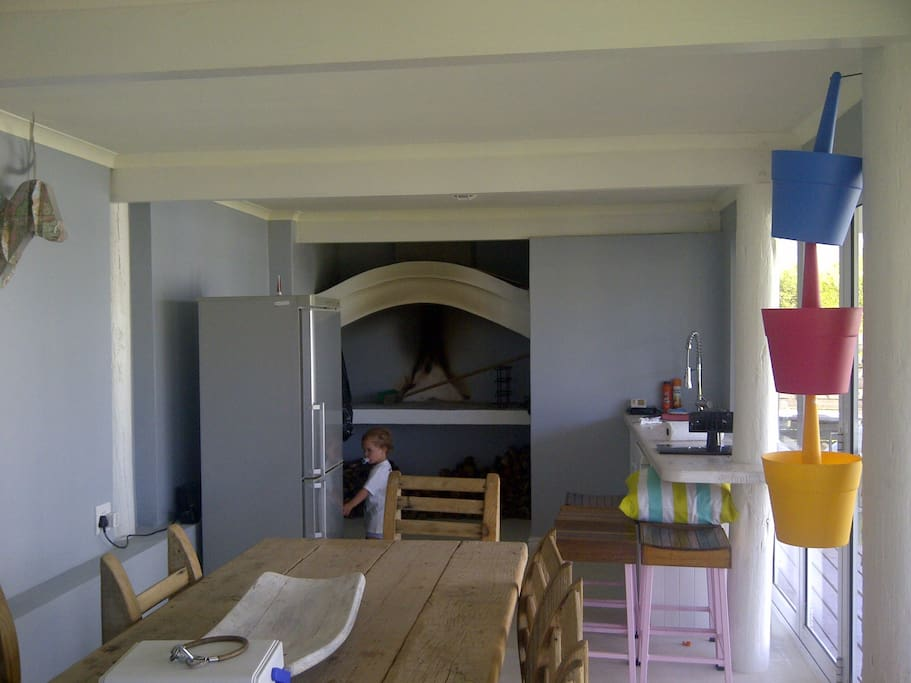 Indoor braai equipped with kitchenette with a dishwasher and fridge, as well as downstairs toilet