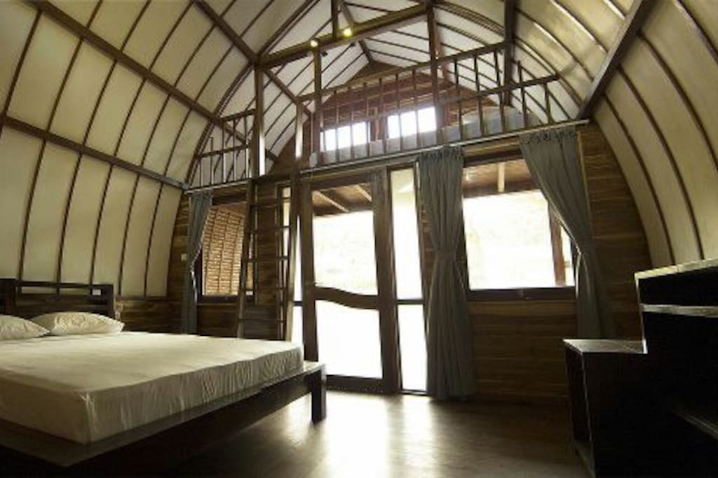 King size bed downstairs and a large standard  bed upstairs in mezzanine