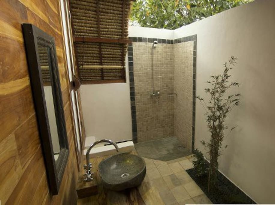 Semi open-air bathroom with fresh hot water