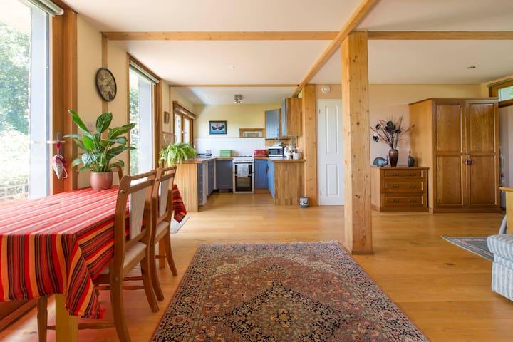 Open plan lodge with oak floors