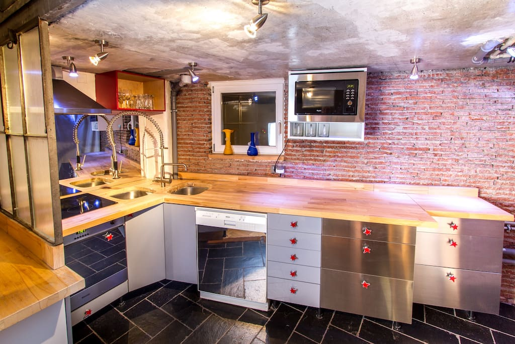 A well equiped modern kitchen. Equipped with small fridge, small freezer, cooker with oven, dishwasher, microwave, kettle, toaster, washing machine