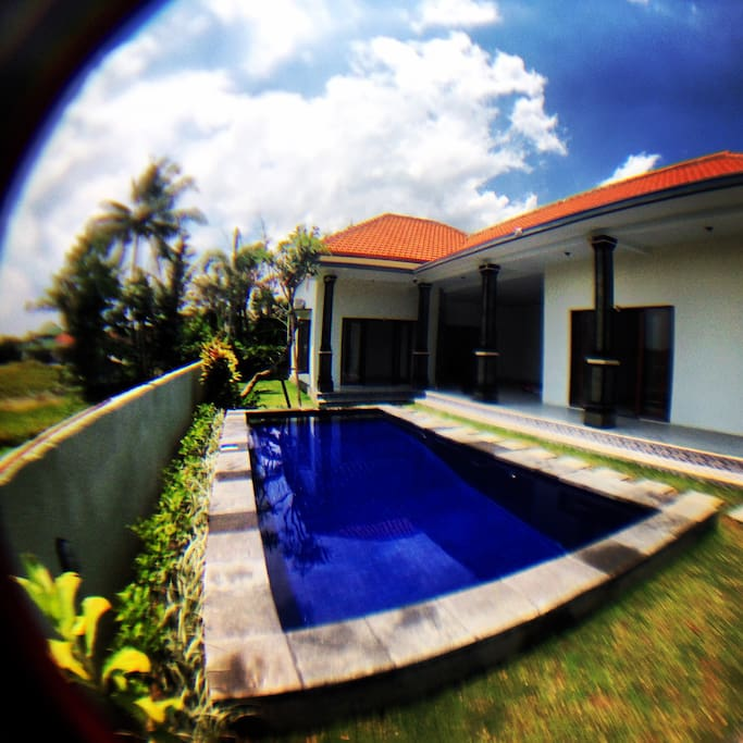 The pool and 2 main bedrooms.