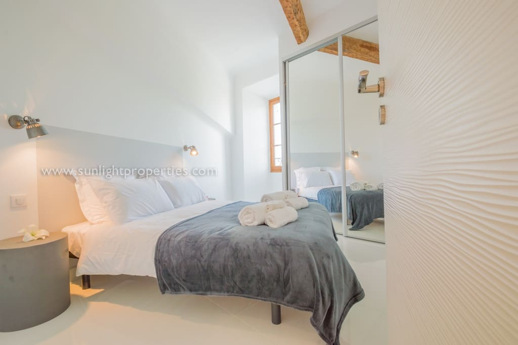 Cozy bedroom with comfortable bed and plenty of storage space.