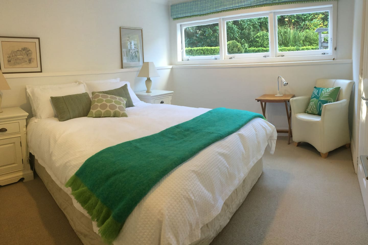 Light, clean bedroom with luxurious 100% cotton bedding and a choice of top quality feather and down duvets. Facing east with morning sun and garden views.