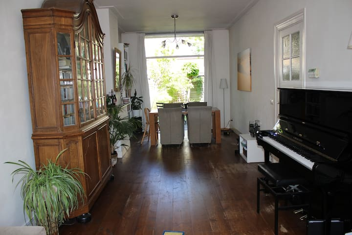 Spacious living room with doors to the garden, and a fantastic piano with an amazing sound, after my house my biggest property!
