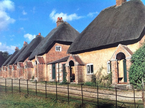 Thatched cottage in rural setting.