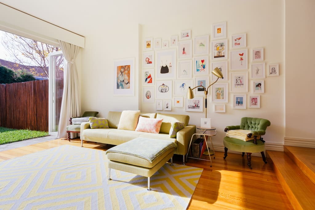 The living room is filled with art.