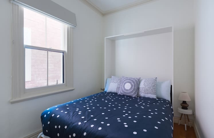 Bedroom 3: Queen bed with 1000 thread count cotton sheets and king quilt. Towels provided. Room has full length mirror and built in wardrobes for your belongings.
