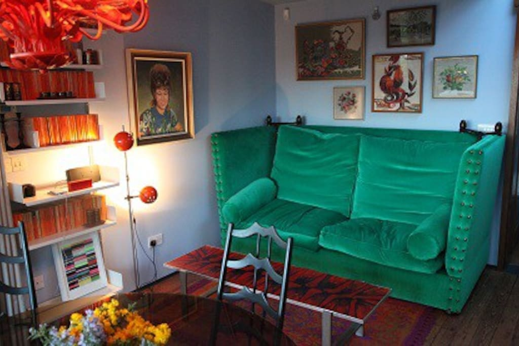 The huge green sofa in the kitchen space is a second sofa bed, and will take for a additional two guests.