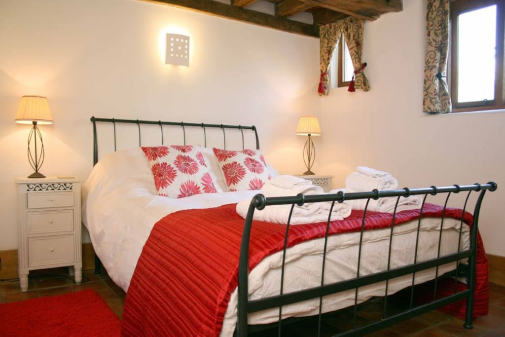 Bramble cottage - double bedroom with double bed, bedside table, dressing table and wardrobe.  Beamed ceilings and tiled floors.