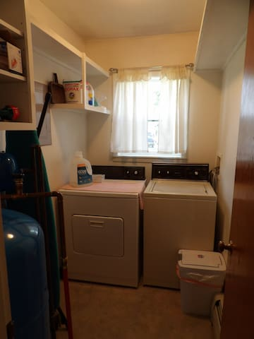 Laundry room, ironing board, washing supplies