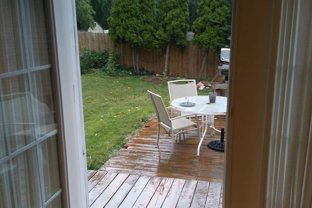 Private patio entrance on a rainy day. You're welcome to use the deck anytime.