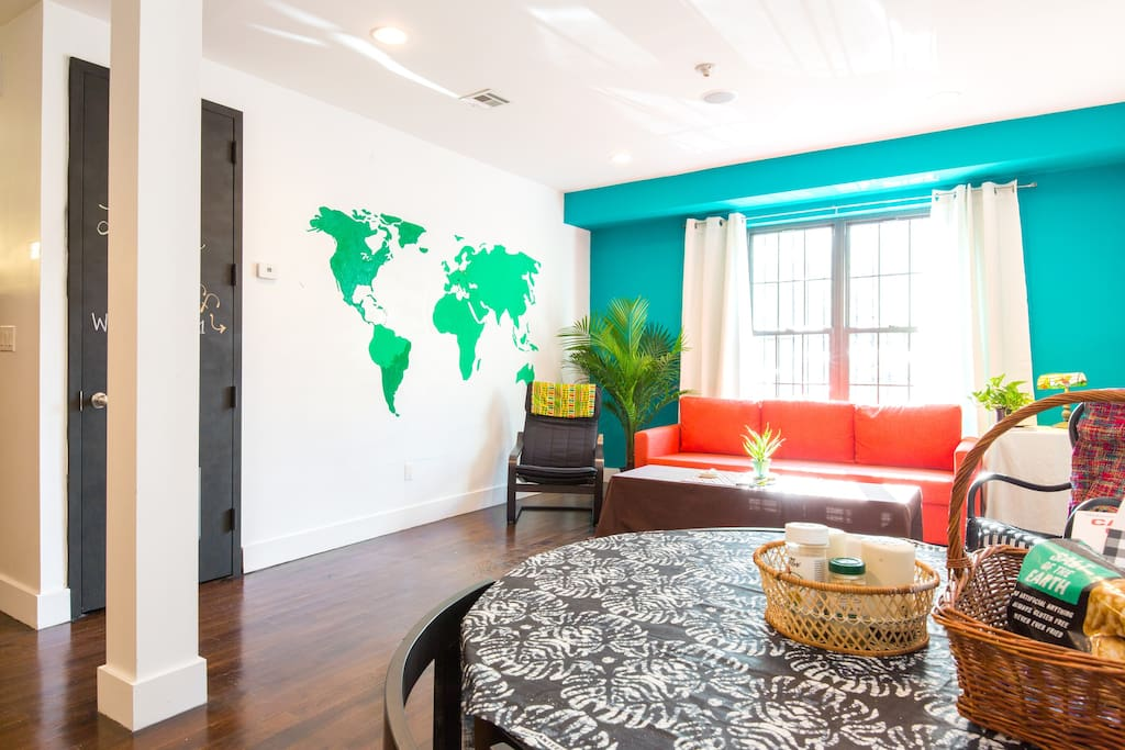 Living room includes world map mural, so guests can put a pin where they are from!