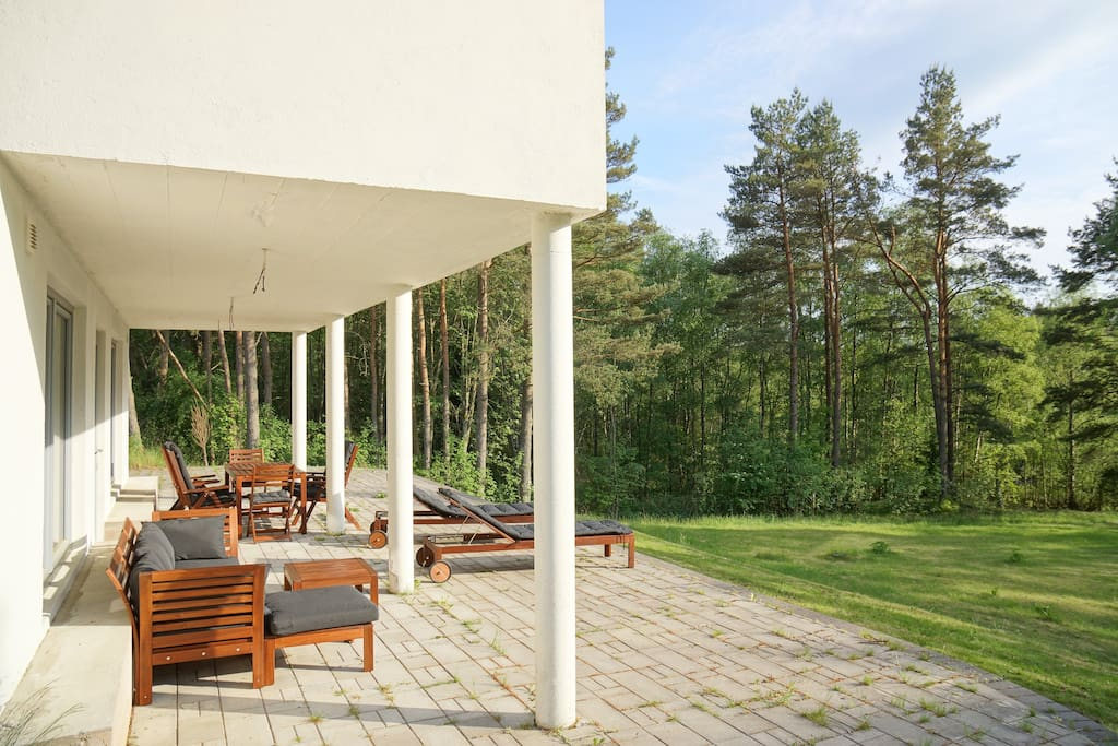 Terrace with sofa, benches and dining table for 12 persons